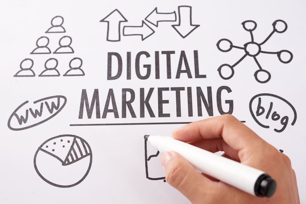 A person drawing the word 'Digital Marketing'.
